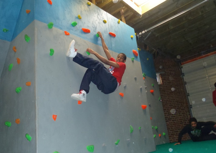 Improving climbing skills at the indoor climbing wall at Shadwell Basin Outdoor Activity Centre