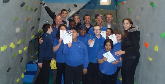 Proud school group at indoor climbing wall