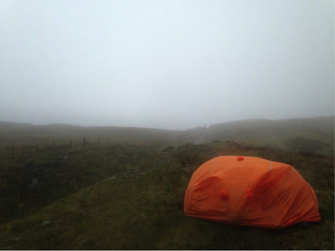 Group Shelter set up on foggy hill